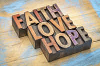 faith, love and hope in wood type