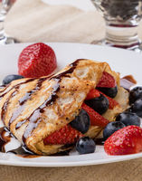 pancake with fruits and chocolate syrup