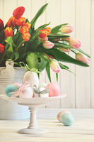 Colored eggs with bows with tulips