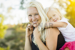 Mother and Little Girl Having Fun Together in Grass