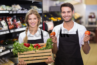 Portrait of a smiling colleagues with fresh vegetables