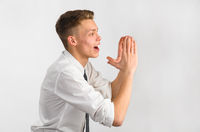 Closeup of a teenager screaming