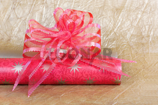 Beautiful red bow for gift decoration on gold background.