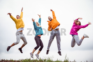 Friends jumping before a hike
