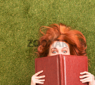 Student girl lying with notebook