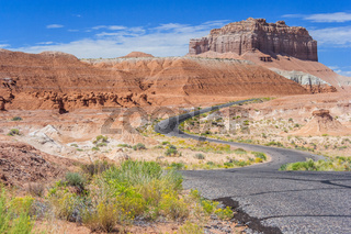 Colorful road in desert painted with different color sediments and rocks near Goblin Valley State Park Utah USA