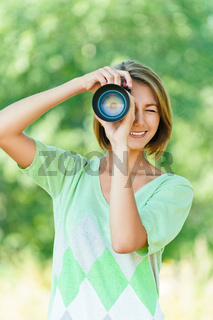 young woman photographed SLR camera