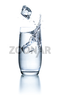 Glass of water with ice cubes and splash