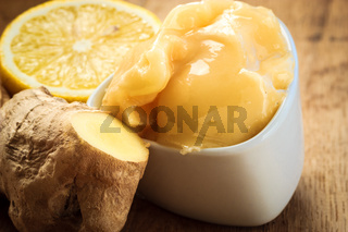 ginger root, honey and lemon on wooden rustic table.