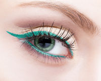 female eye zone and brow with evening green eyeliner makeup