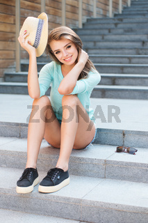 Pretty Girl in Trendy Outfit Sitting on Stairs