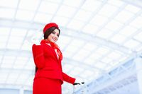 Smiling stewardess in a form