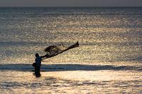 Fisherman on Bali throws net