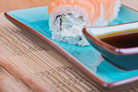 California maki sushi with fish on azul plate