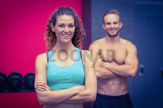 Muscular couple looking at the camera