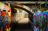 With graffiti sprayed railway underpass
