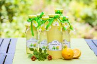 Bottles with lemon balm syrup