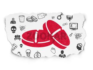 Medicine concept: Pills on Torn Paper background