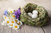Organic white eggs and meadow flowers