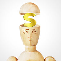 Golden dollar sign into the human head. Abstract image with a wooden puppet