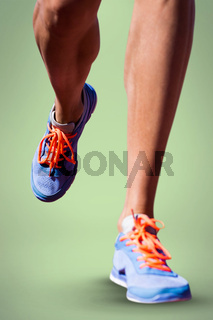 Composite image of close up of sportsman legs walking on a white background