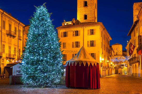 Illuminated Christmas tree on town square.