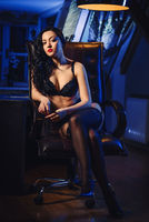 Woman in lingerie and stockings indoors
