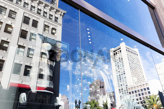 double exposure of manequins and modern office buildings