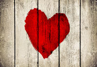 Heart on old wooden wall