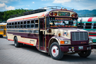 Maroon and Beige Jeepney bus truck Parked on The Side