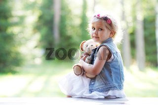young girl with teddybear