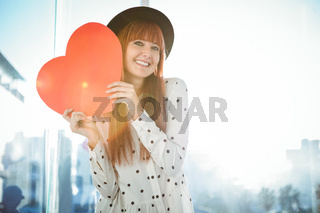 Attractive hipster woman behind a red heart
