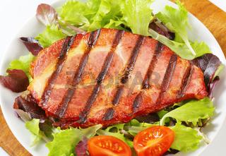 Grilled pork with salad greens