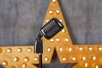 Vintage microphone in studio with star