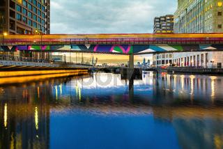 DLR Train Passing over bridge, Canary Wharf, London, United Kingdom