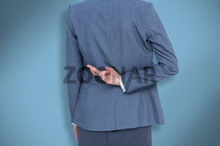 Composite image of businesswoman with fingers crossed behind her back