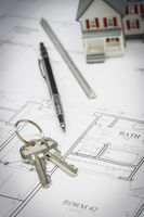 Home, Pencil, Ruler and Keys Resting On House Plans