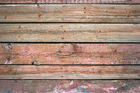 Rustic weathered barn wood background painted in red color