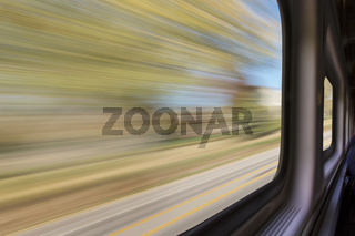 blurred abstract landscape from train
