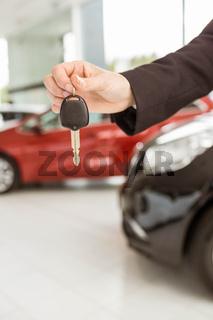 Saleswoman holding a car key