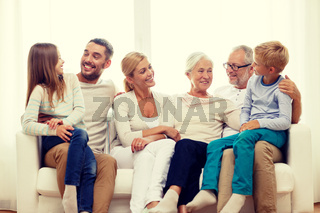 happy family sitting on couch at home