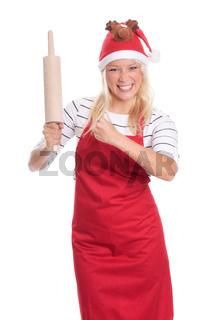 weihnachtsfrau in schürze hält eine teigrolle