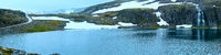 Summer mountain panorama with lake and snow (Norway)