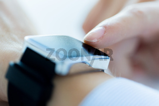 close up of hands setting smart watch