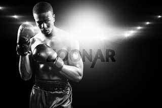 Composite image of portrait of boxer performing uppercut