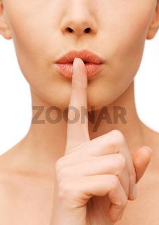 woman making a hush gesture