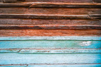 Old wooden background half painted in blue