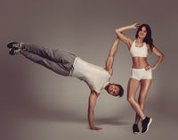 Young athletic couple, studio shot