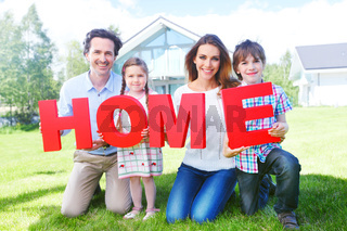 family holding home letters