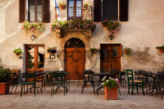 Retro romantic restaurant, cafe in a small Italian town. Vintage Italy